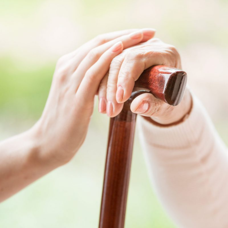 Close-up,Of,Caregiver,Holding,Hand,Of,A,Senior,Person,With