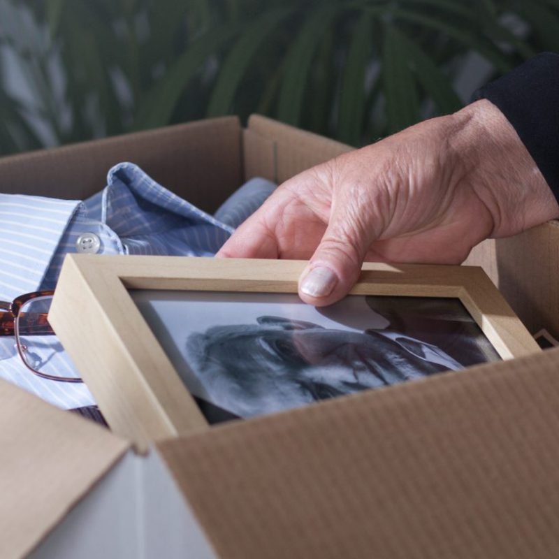 Woman,Packing,Dead,Husband's,Photography,To,Moving,Box